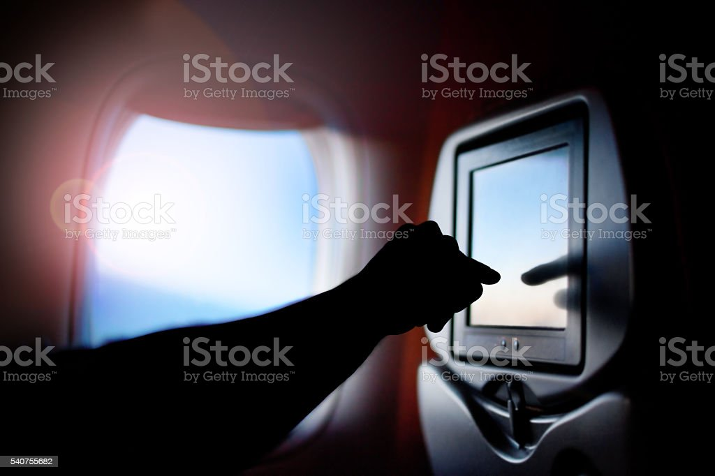 Modern monitor passenger seat on the plane. Airplane window. stock photo