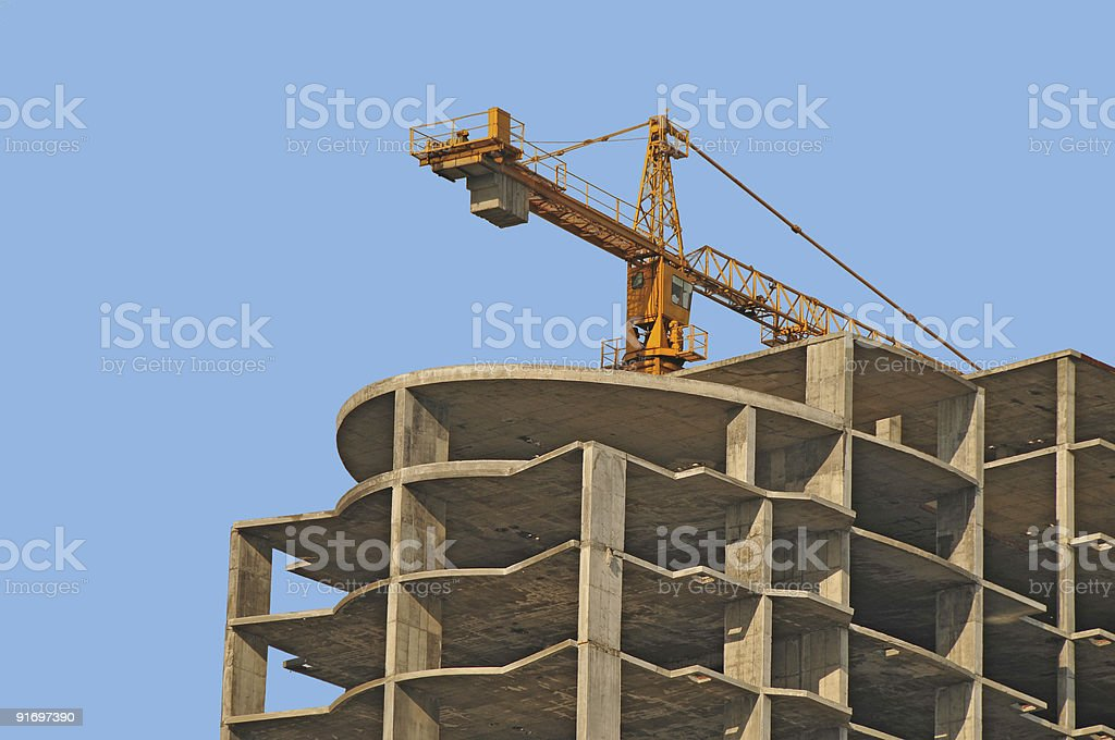 modern monolithic housebuilding and crane stock photo