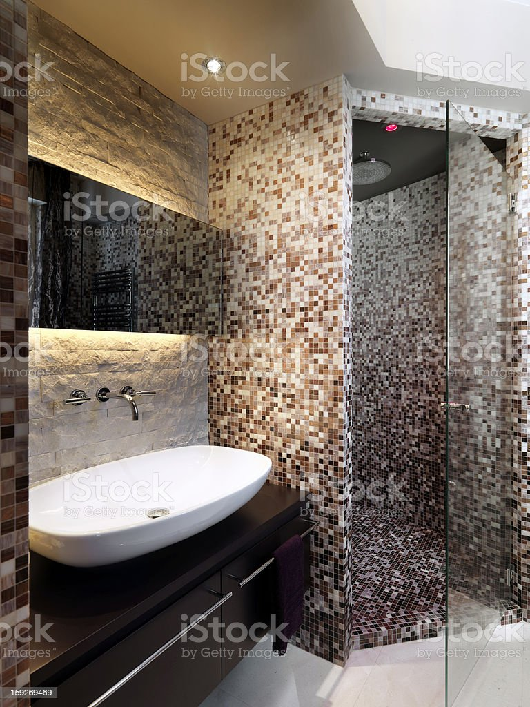 Modern mosaic bathroom with sink, masonry shower royalty-free stock photo