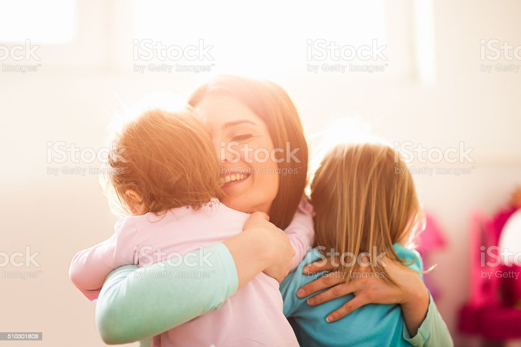 Modern mother with daughters stock photo