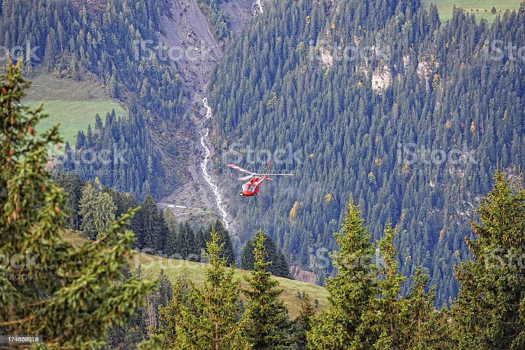 Modern Multi-purpose Helicopter Flying in Bernese Alps royalty-free stock photo