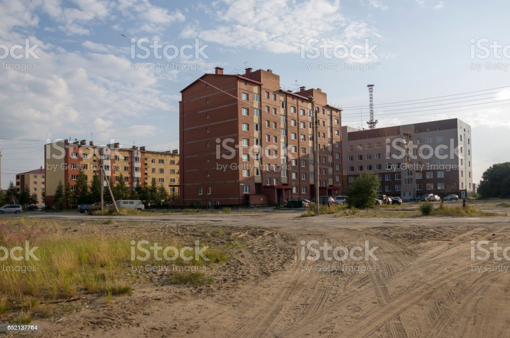 Modern multi-storeyed buildings with telecommunications tower behind stock photo