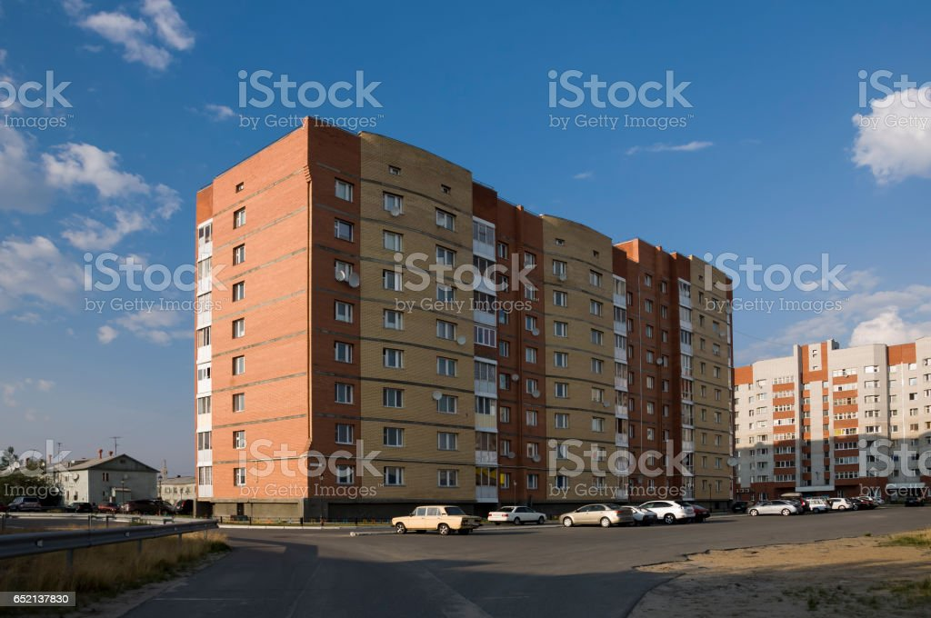 Modern multi-storeyed house with flats. Was built from yellow and orange color stock photo