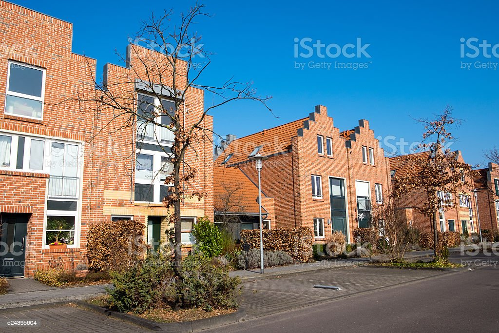 Modern neighborhood with red houses stock photo