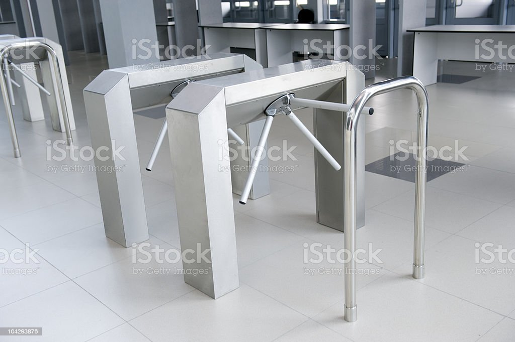 Modern new turnstile with silver handrails stock photo