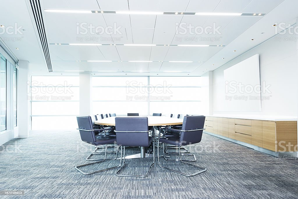 Modern Office Boardroom With Table Chairs and Screen stock photo