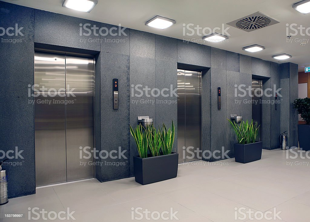 modern office building and elevators stock photo