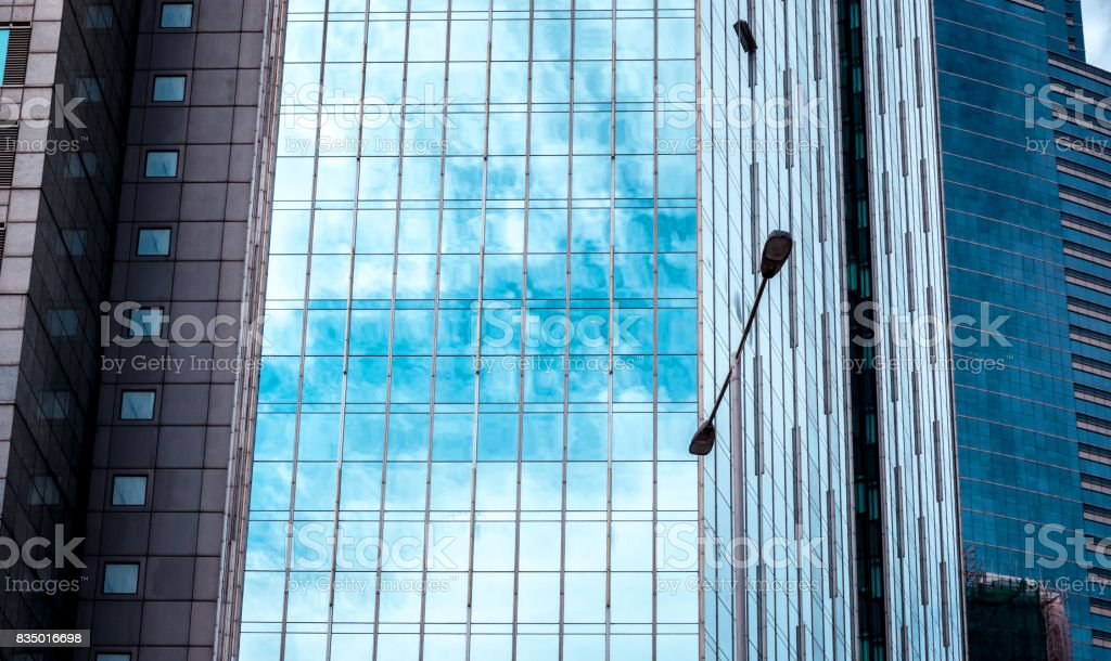 Modern office building detail, glass surface stock photo