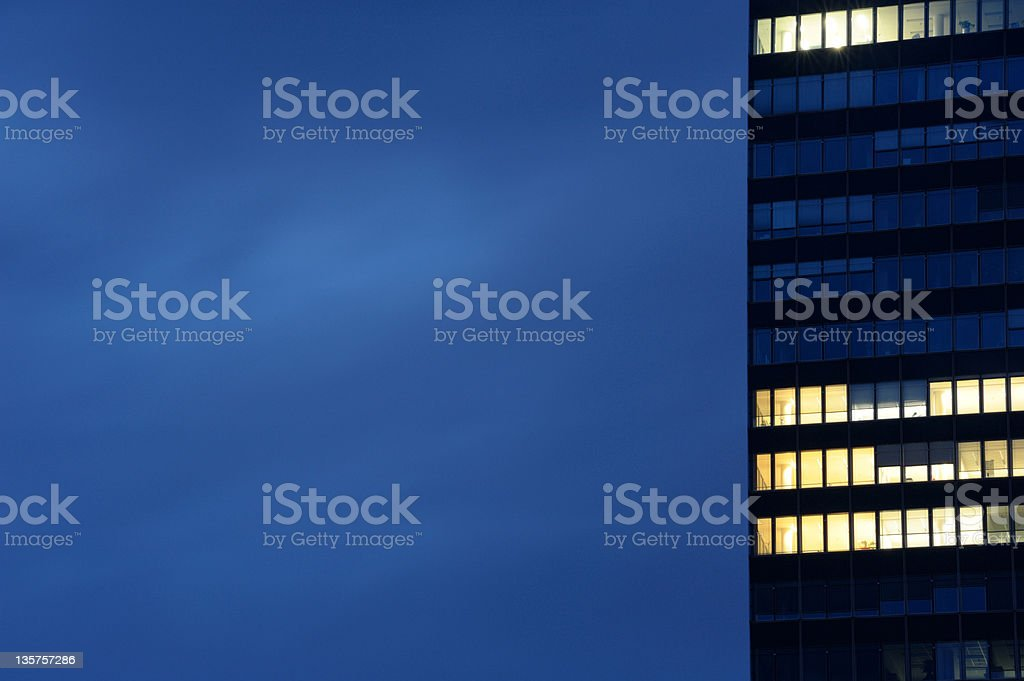 Modern office building in dusk royalty-free stock photo