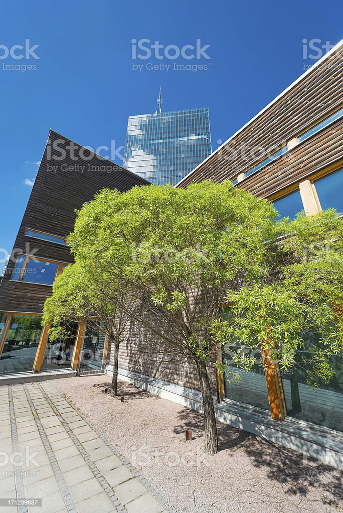 Modern office building in green environment, royalty-free stock photo
