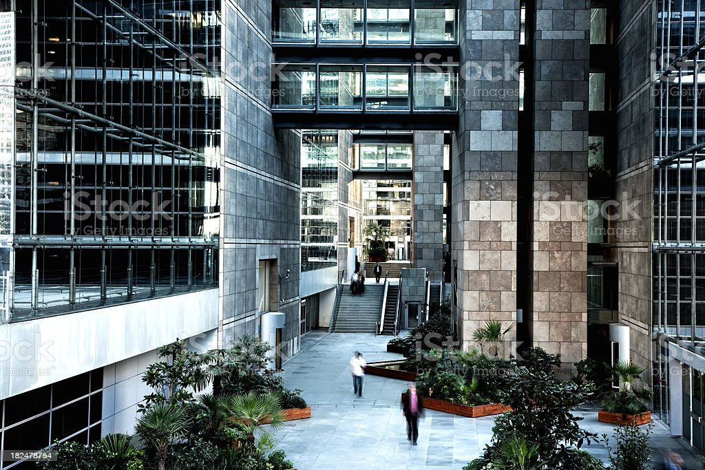 Modern Office Building Interior With Walking Business People royalty-free stock photo