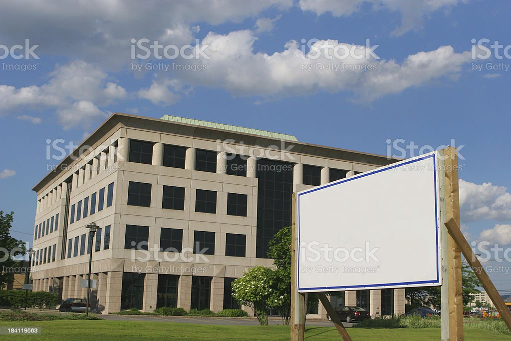 Modern Office Building with a blank real estate sign stock photo