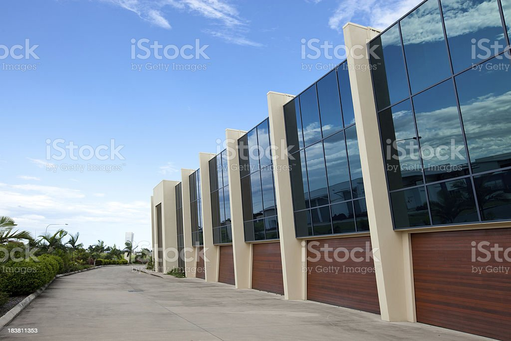 Modern Office Building with blue sky and cloud reflection royalty-free stock photo