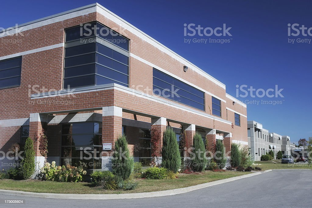 Modern Office Building with Plants and Trees royalty-free stock photo