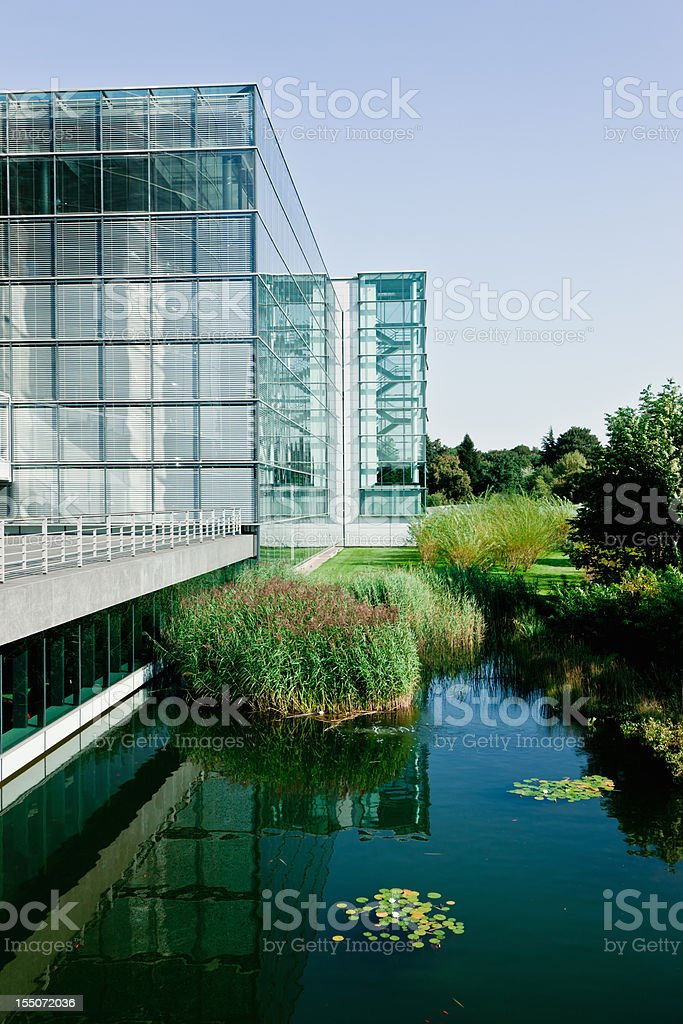 Modern Office Building with Pond in Natural Environment royalty-free stock photo
