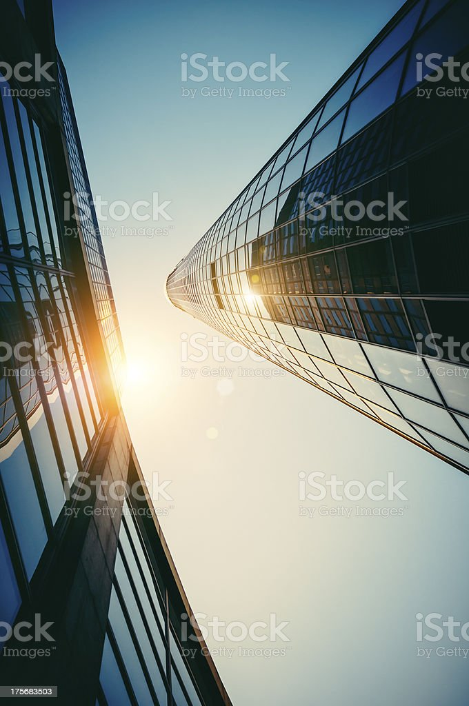 Modern office building with reflecting sun at dawn royalty-free stock photo