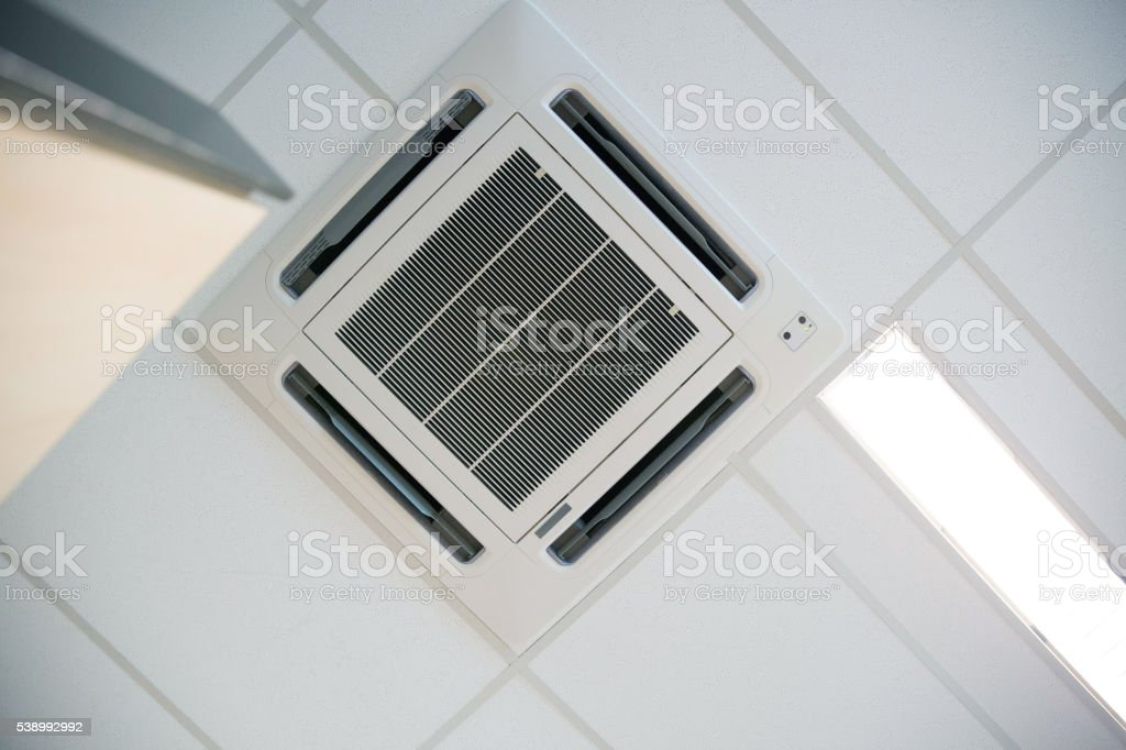 Modern Office Ceiling Air Conditioning System stock photo