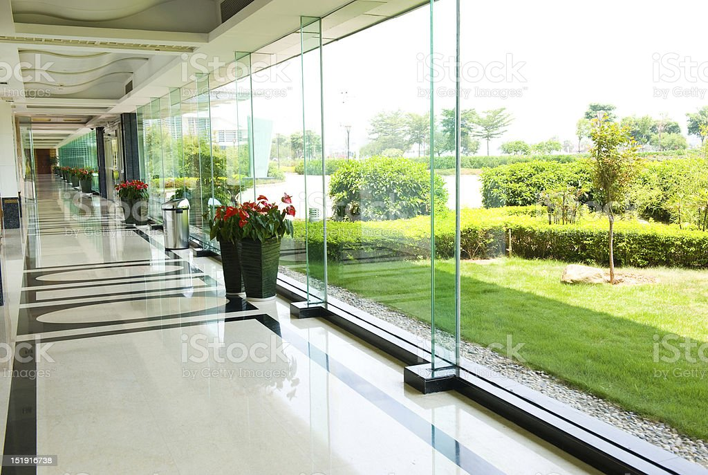 A modern office corridor with glass walls stock photo