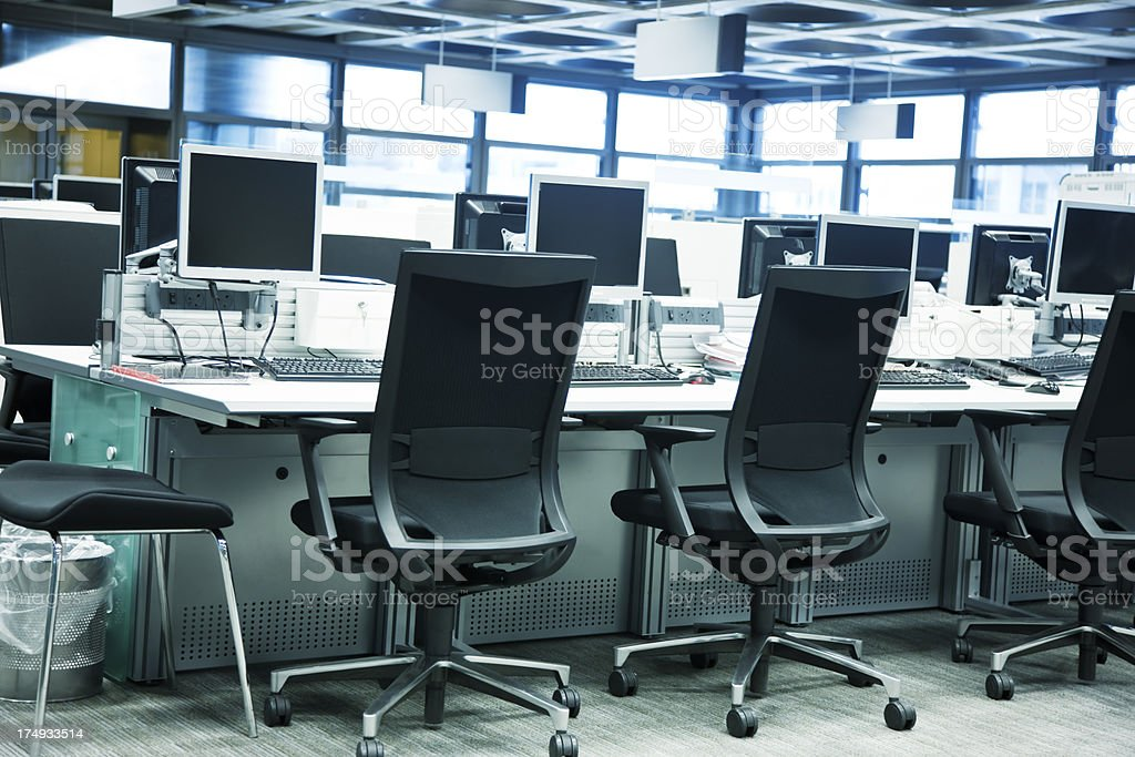 Modern Office Interior with Rows of Chairs and Computer Screens royalty-free stock photo
