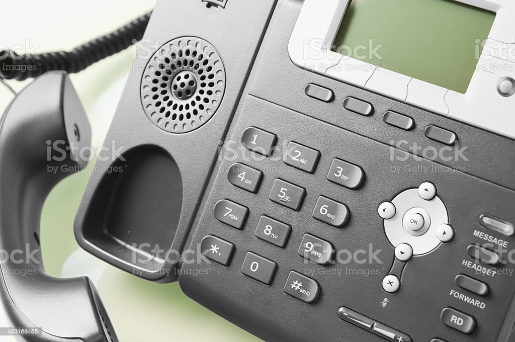 Modern office telephone with receiver off the hook royalty-free stock photo