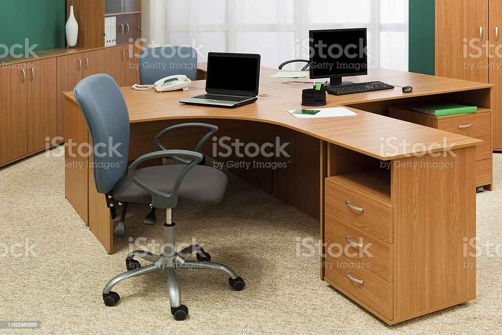 Modern office with wooden desks and cabinets stock photo
