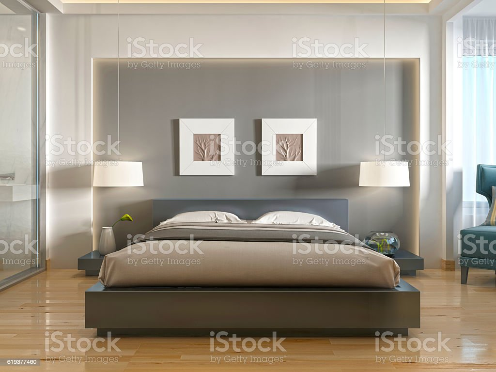 Modern one double bed front view, with niche at head. stock photo