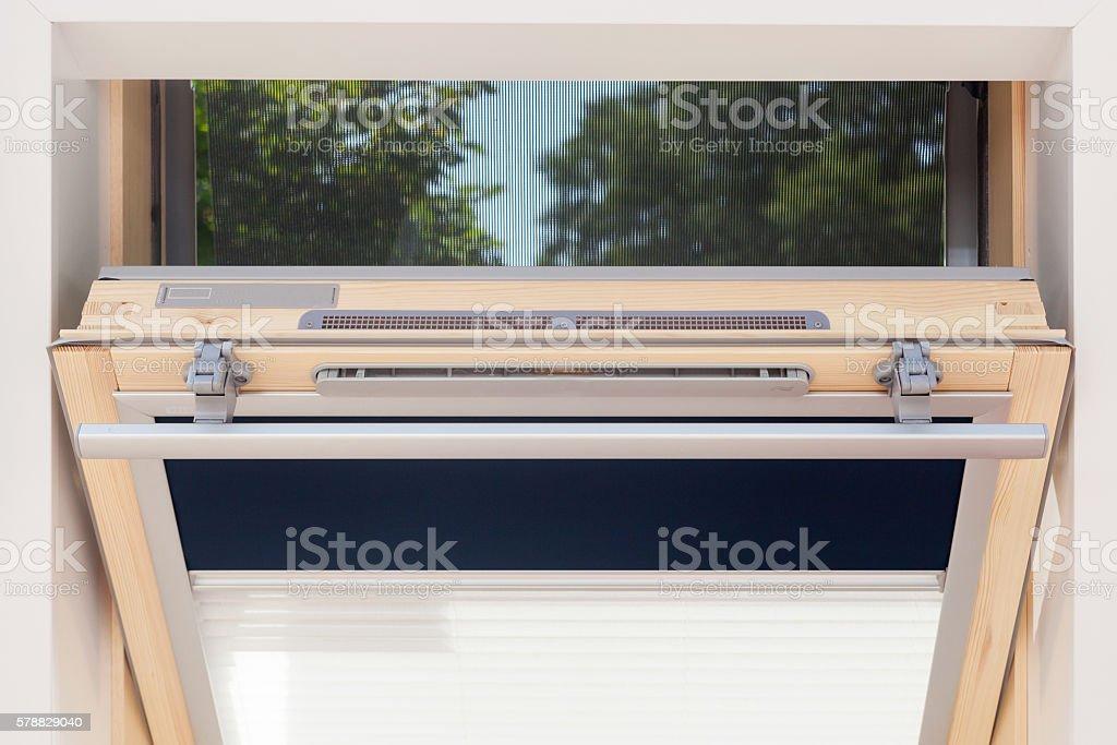 Modern open skylight (mansard window) stock photo