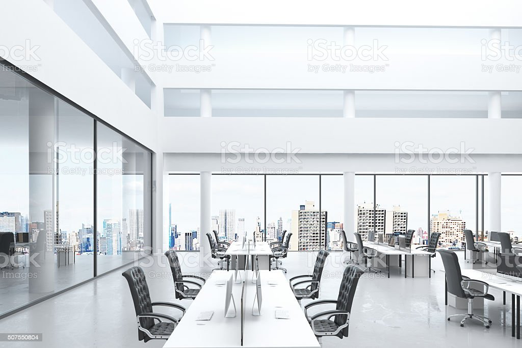 Modern open space office with big windows and furniture stock photo
