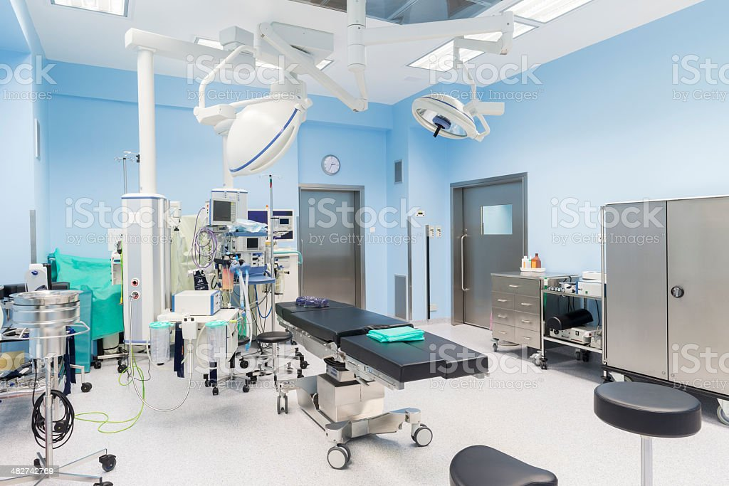 Modern operating room interior, fully equipped, ready for operation stock photo
