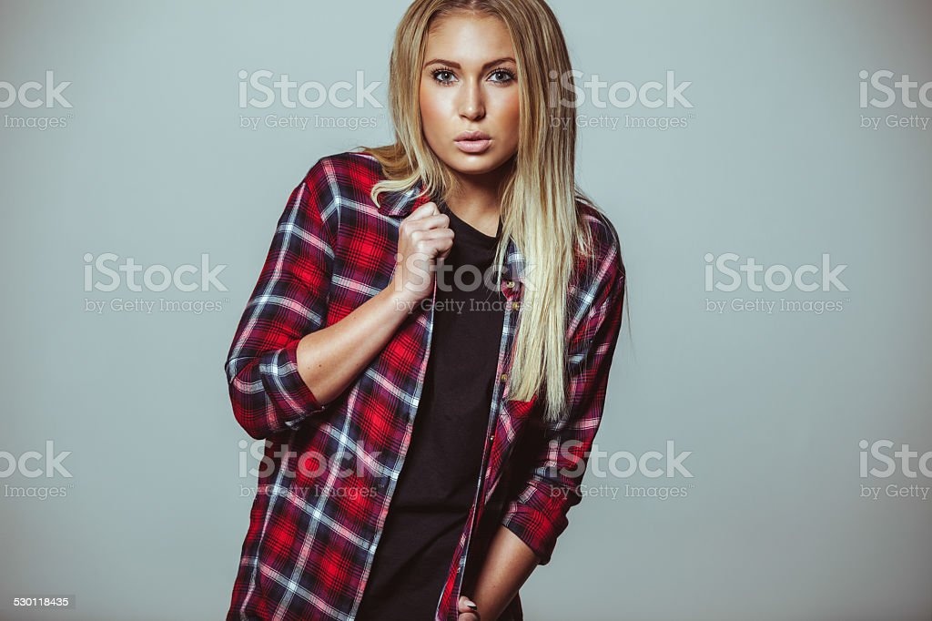 Modern outfit on young adult woman stock photo