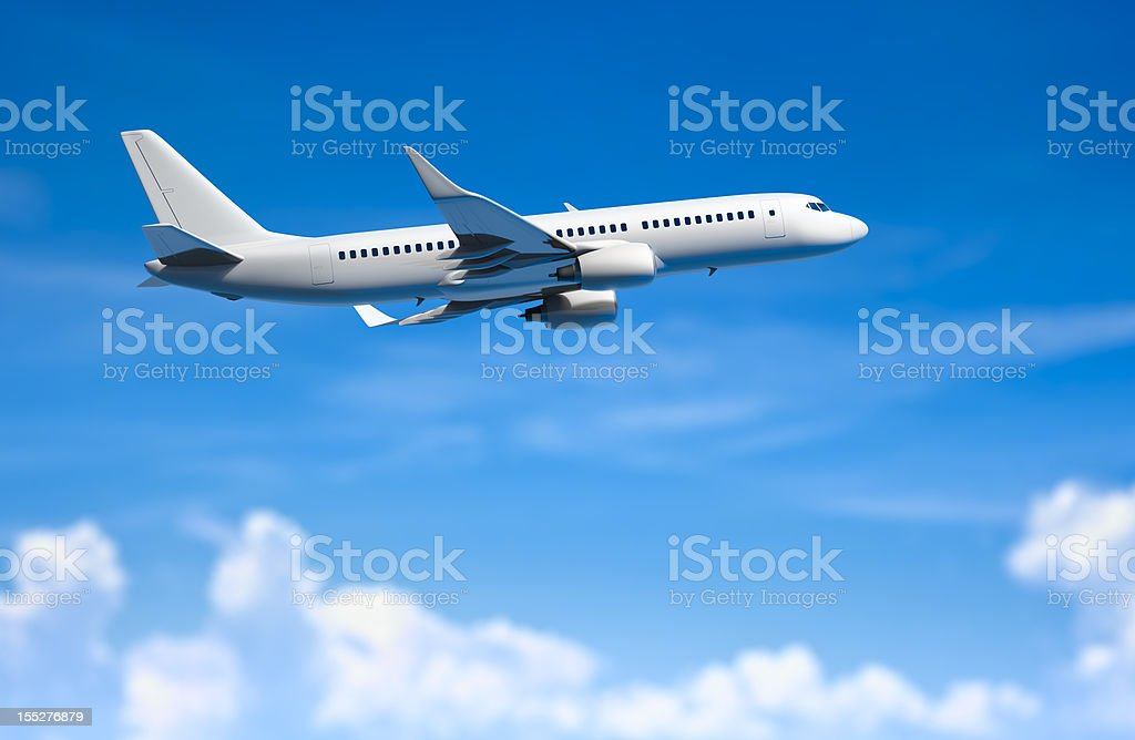 Modern passanger airplane flying above clouds. stock photo