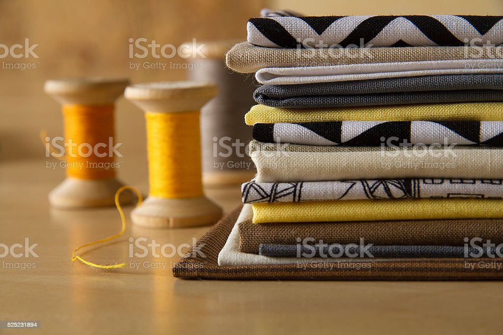 Modern patchwork fabrics in black, brown, white, yellow and grey stock photo