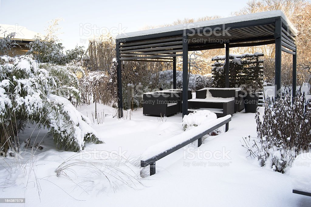 Modern patio with a pergola during winter stock photo