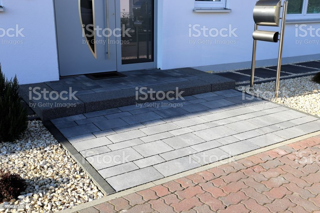 Modern paved entry area on a residential home stock photo