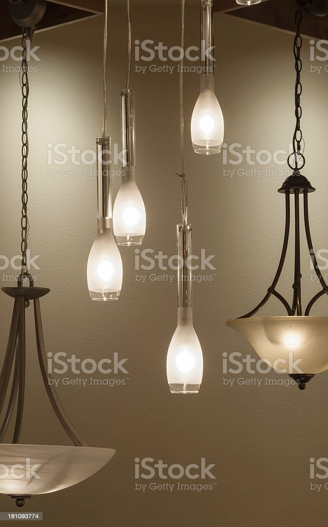 Modern pendant lamps against a plain wall stock photo