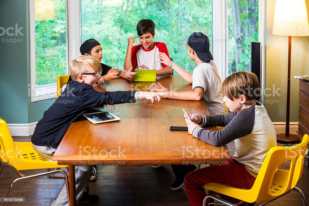 Modern play, boys with digital devices. stock photo