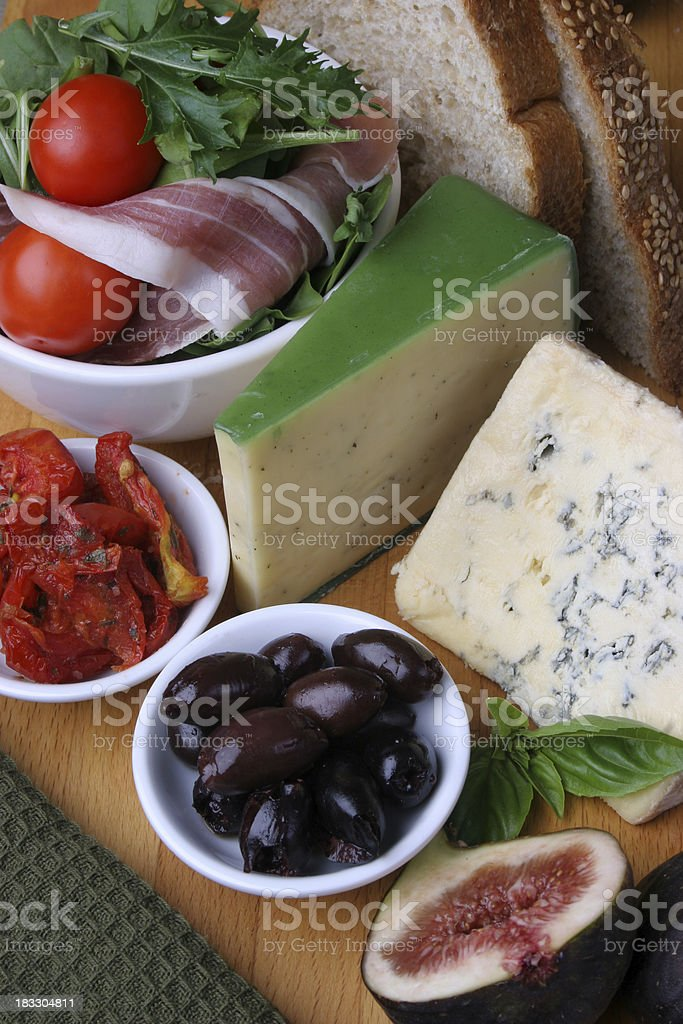 Modern Ploughmans lunch with cheese and bread royalty-free stock photo