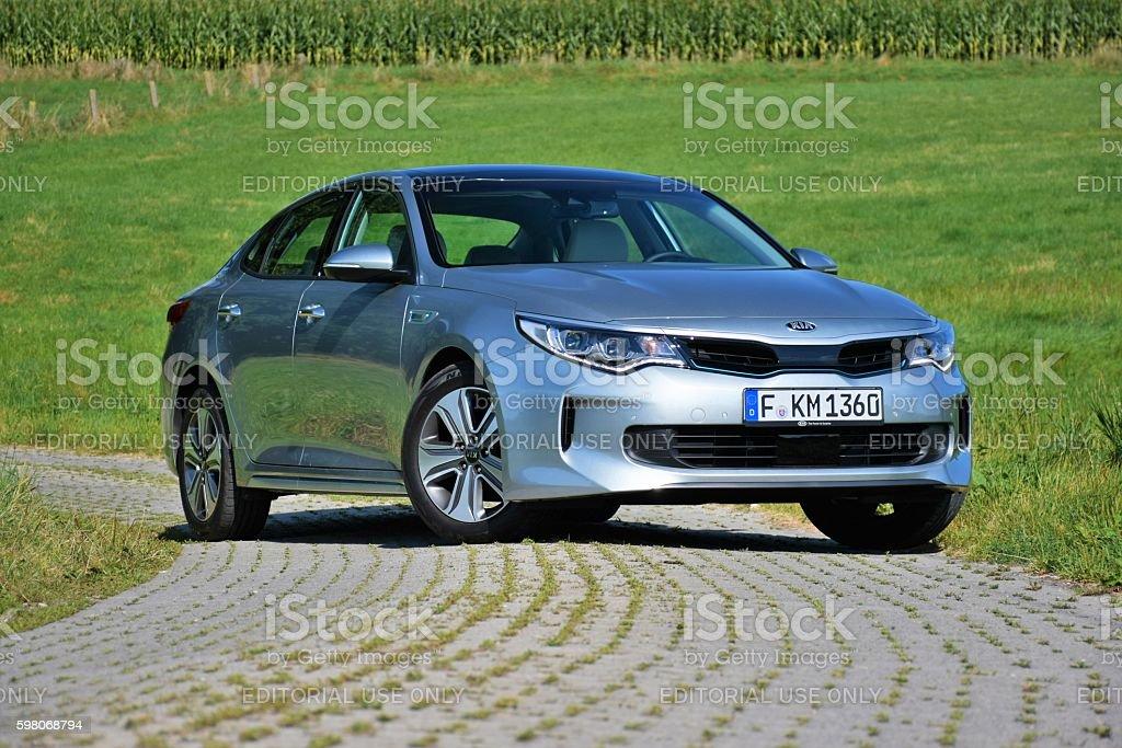 Modern plug-in hybrid sedan stock photo