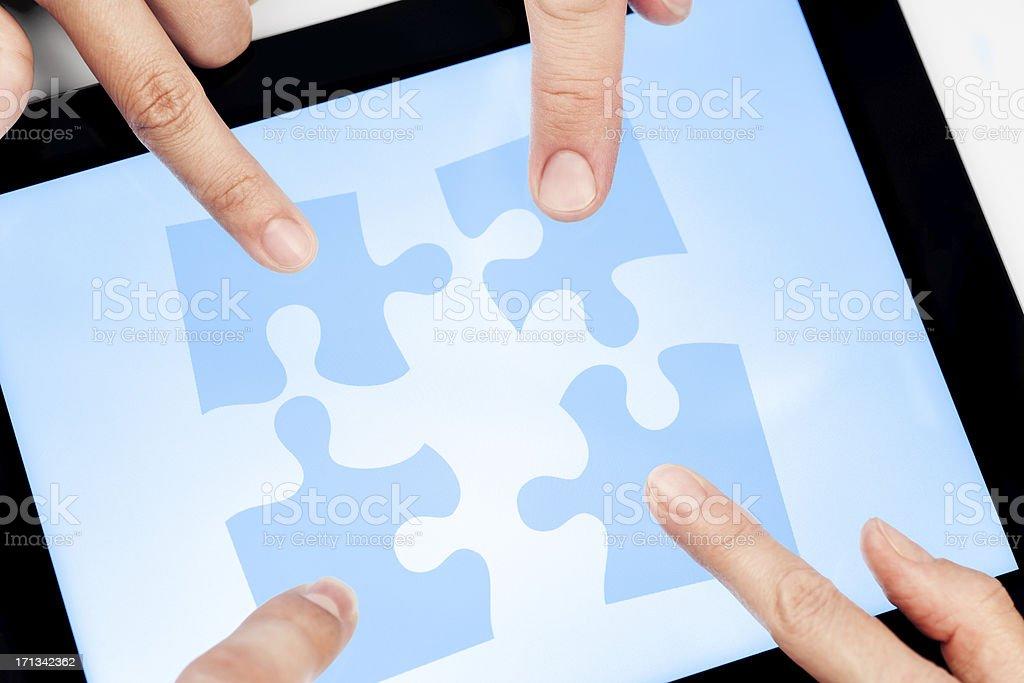 Modern problem-solving through teamwork. stock photo