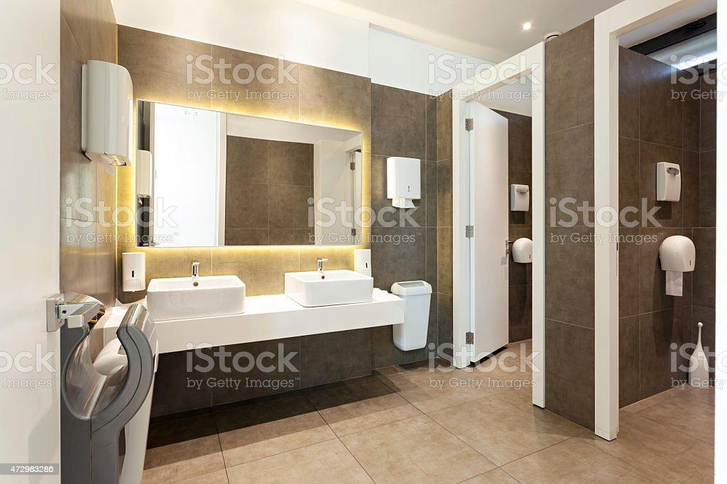 A modern public restroom interior example stock photo