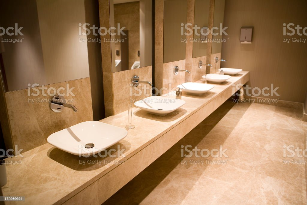 Modern public restroom sinks in marble countertop royalty-free stock photo