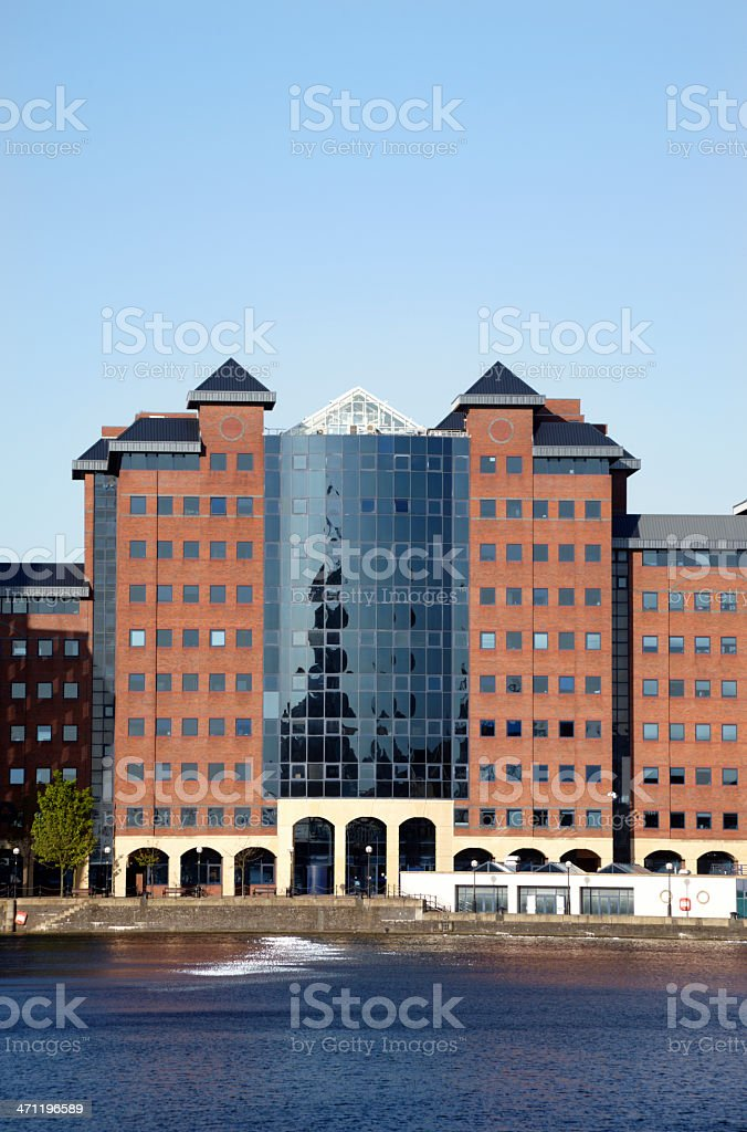 Modern Quayside Office Facade with clear blue sky royalty-free stock photo