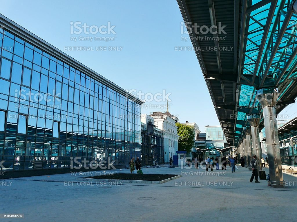 Modern Railway Station Platform with Passengers in Early Morning stock photo