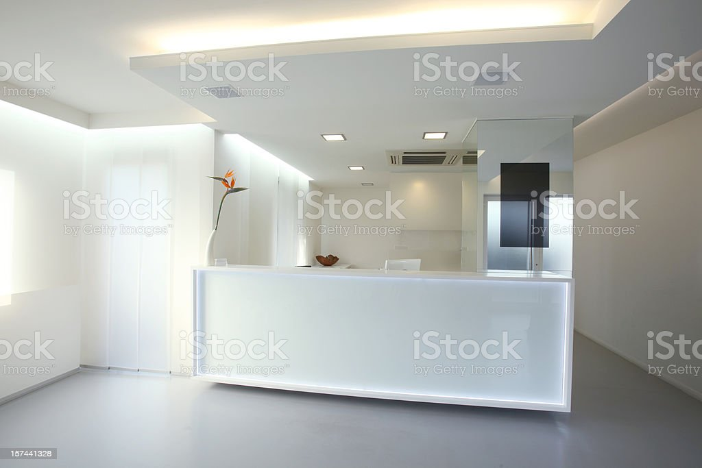Modern reception desk in grey white color (XXXL) stock photo
