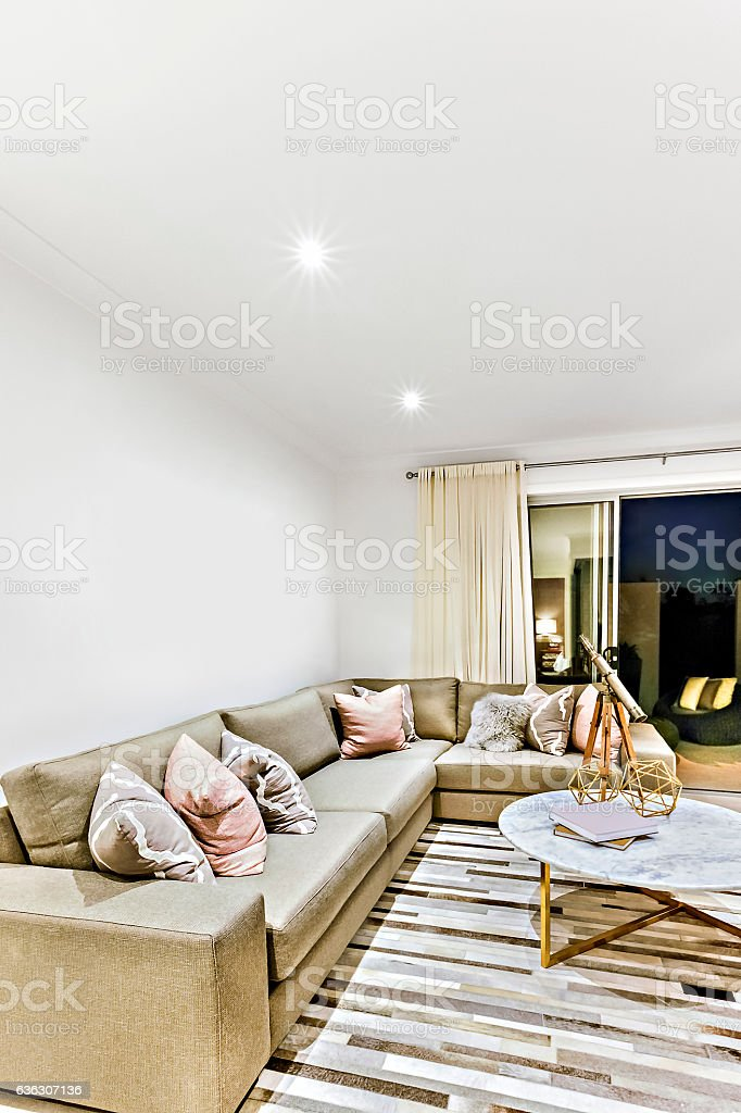 Modern relaxing area with chairs and pillows stock photo