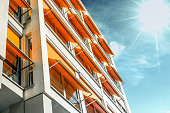 modern residential house with orange awnings in sunny Berlin
