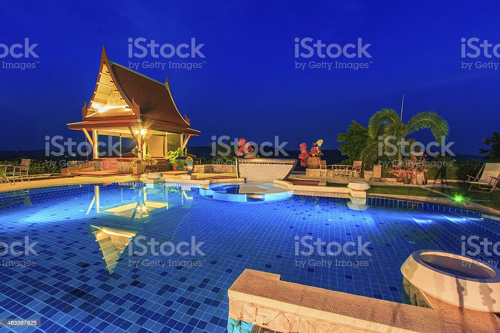 Modern resort with swimming pool at night royalty-free stock photo