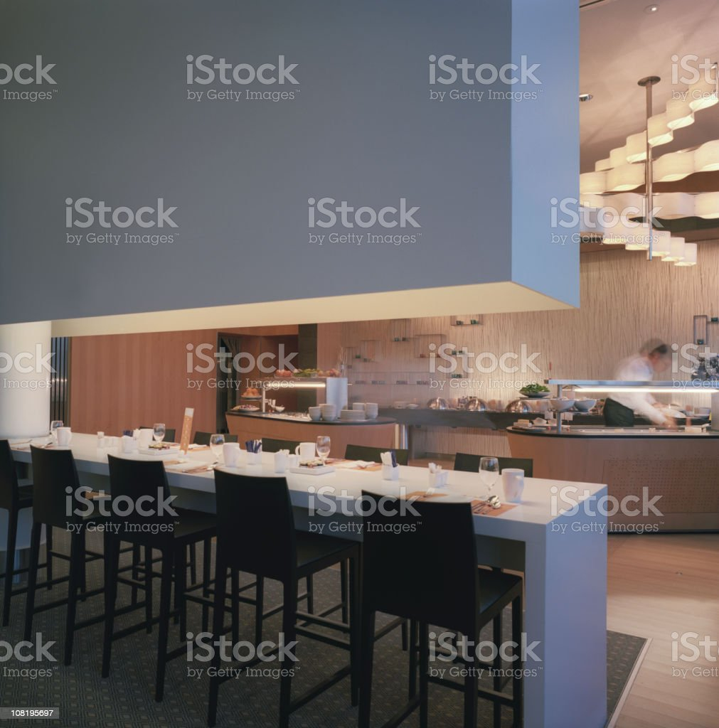 Modern Restaurant Interior with Bar Facing Kitchen royalty-free stock photo