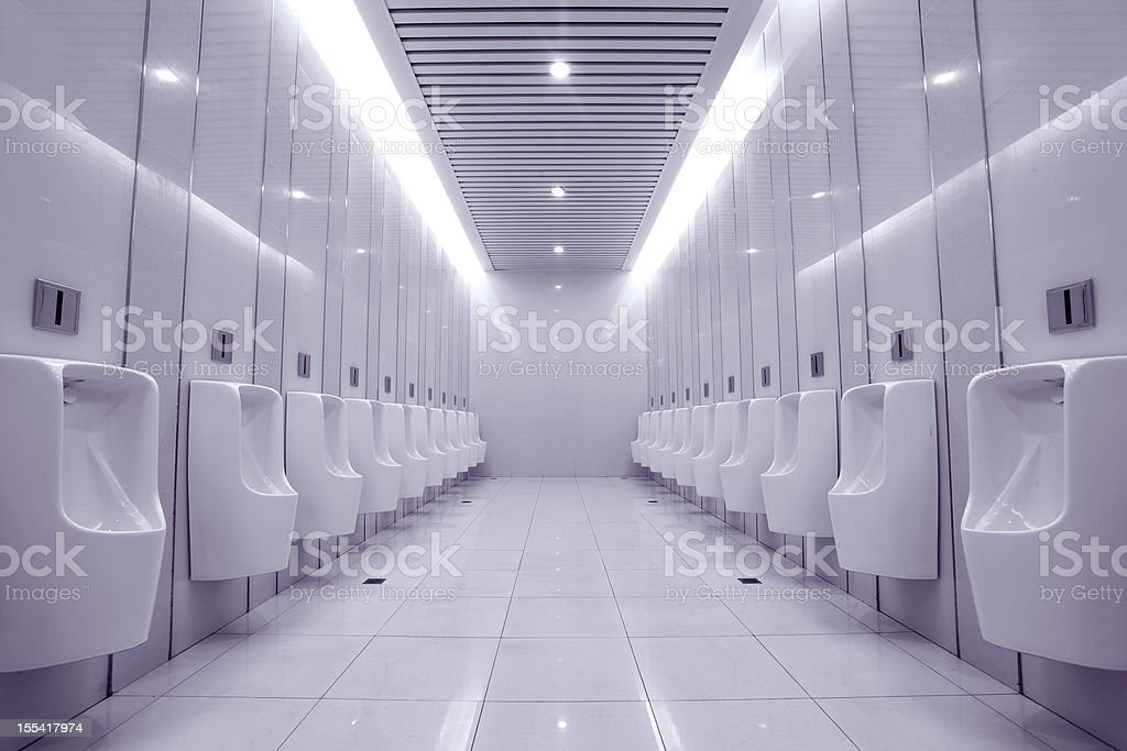 modern restroom interior with urinal row royalty-free stock photo