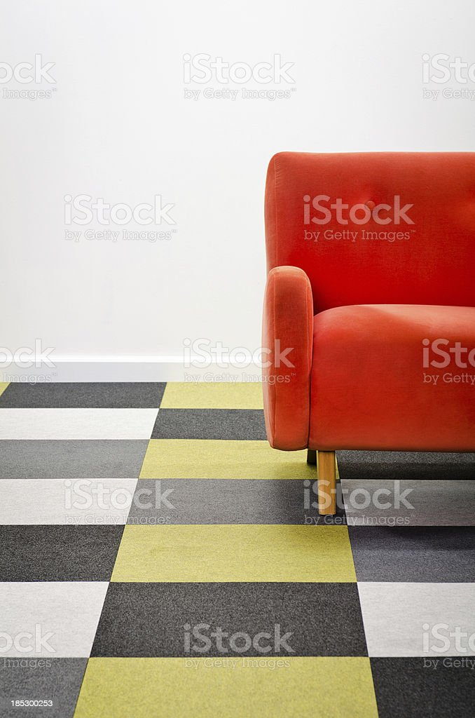 Modern Room With Checkered Carpeting & Armchair royalty-free stock photo